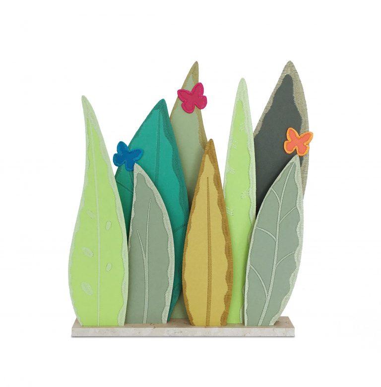 Vitrine Van Cleef & Arpels feuilles cuir